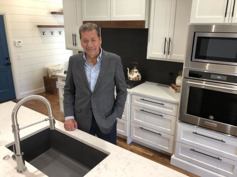 Photo -  John Nail, homebuilder and developer, shows the kitchen in his model home at 2221 War Eagle Lane in Yukon. The 2,950-square-foot home is priced at $495,000. [RICHARD MIZE/THE OKLAHOMAN]