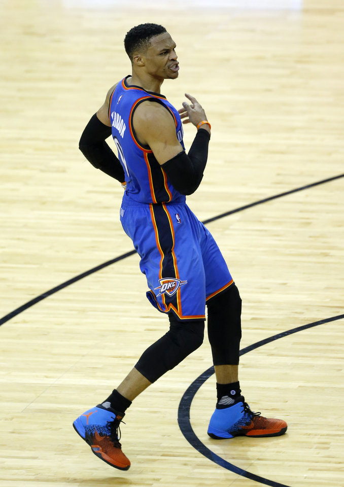 Photo - Oklahoma City's Russell Westbrook (0) argues for a call during Game 2 in the first round of the NBA playoffs between the Oklahoma City Thunder and the Houston Rockets in Houston, Texas,  Wednesday, April 19, 2017.  Photo by Sarah Phipps, The Oklahoman