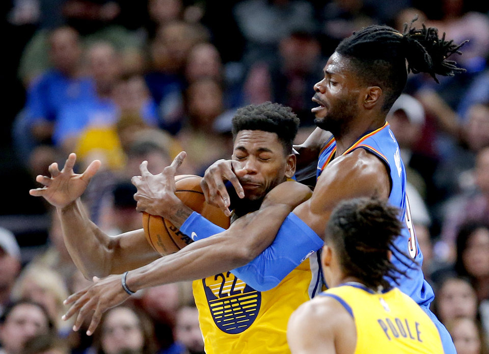 Photo - Oklahoma City's Nerlens Noel (9) fights for a rebound with Golden State's Glenn Robinson III (22) during the NBA game between the Oklahoma City Thunder and the Golden State Warriors at Chesapeake Energy Arena,   Saturday, Nov. 9, 2019.  [Sarah Phipps/The Oklahoman]