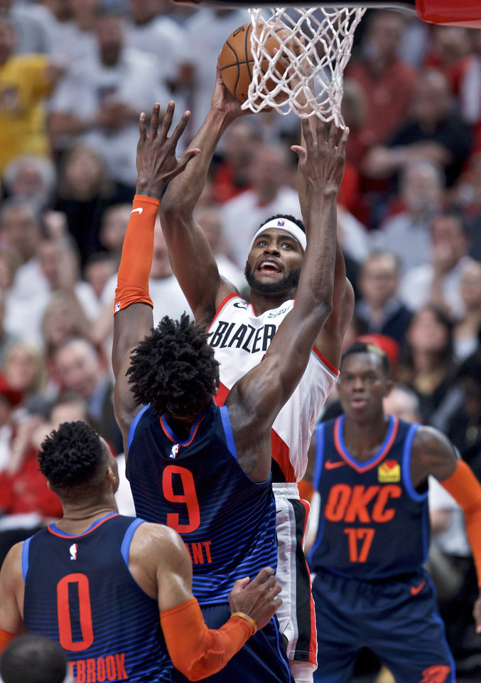 Photo - Portland Trail Blazers forward Maurice Harkless, center, shoots over Oklahoma City Thunder forward Jerami Grant during the first half of Game 5 of an NBA basketball first-round playoff series, Tuesday, April 23, 2019, in Portland, Ore. (AP Photo/Craig Mitchelldyer)