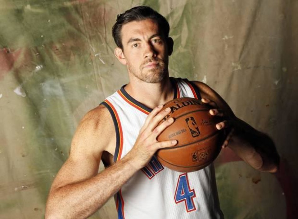 Photo - Nick Collison (4) during media day for the Oklahoma City Thunder NBA basketball team at Chesapeake Energy Arena in Oklahoma City, Monday, Sept. 28, 2015. Photo by Nate Billings, The Oklahoman