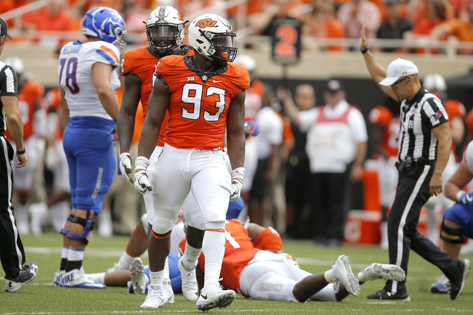 Photo - Oklahoma State's Jarrell Owens (93) celebrates after a sack during a college football game between the Oklahoma State University Cowboys (OSU) and the Boise State Broncos at Boone Pickens Stadium in Stillwater, Okla., Saturday, Sept. 15, 2018. Oklahoma State won 44-21. Photo by Bryan Terry, The Oklahoman