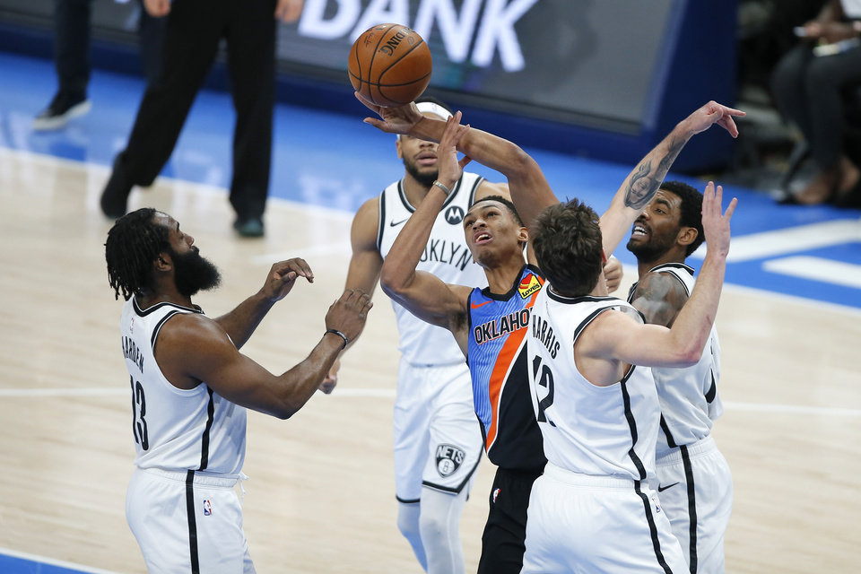 Photo - Oklahoma City's Darius Bazley (7) tries to control the ball between Brooklyn's James Harden (13), Joe Harris (12) and Kyrie Irving (11) during an NBA basketball game between the Oklahoma City Thunder and the Brooklyn Nets at Chesapeake Energy Arena in Oklahoma City, Friday, Jan. 29, 2021. [Bryan Terry/The Oklahoman]
