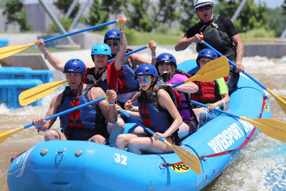 Photo -  A focused group of rafters take on the rapids at Riversport OKC. [Provided by Riversport OKC]