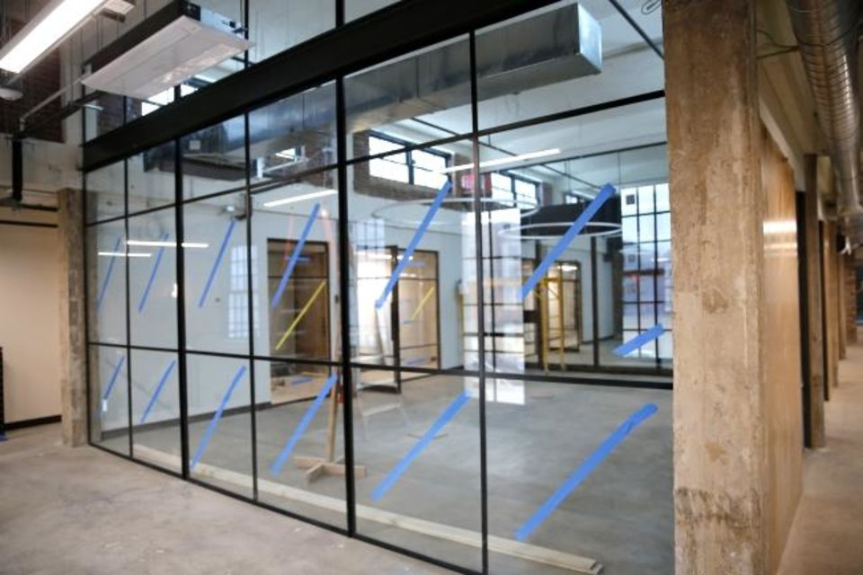 Photo -  Glass-walled boardrooms allow for a clear view of the entrance at 400 N Walnut. [SARAH PHIPPS/THE OKLAHOMAN]