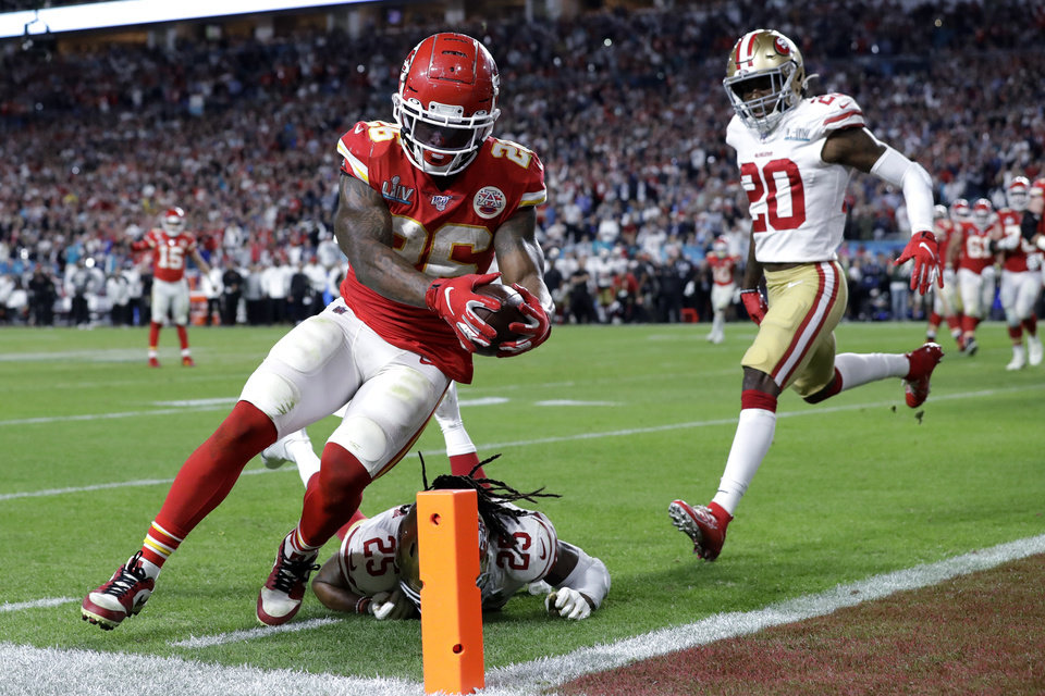 Photo - Kansas City Chiefs' Damien Williams (26) scores a touchdown against the San Francisco 49ers during the second half of the NFL Super Bowl 54 football game Sunday, Feb. 2, 2020, in Miami Gardens, Fla. (AP Photo/Mark Humphrey)