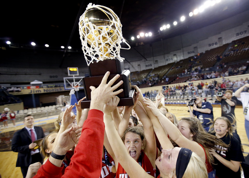 Photo - Howe celebrates the 2A girls state high school basketball championship over Dale at Jim Norick State Fair Arena, the Big House, at State Fair Park in Oklahoma City,  Saturday, March 9, 2019. Photo by Sarah Phipps, The Oklahoman
