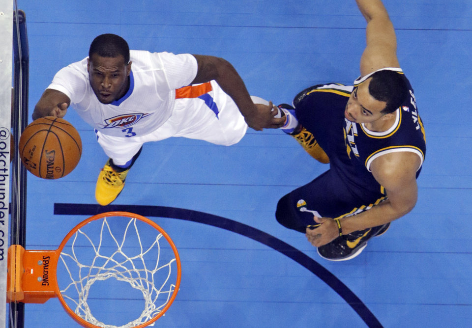 Photo - Thunder's Dion Waiters (3) shoots guarded by Utah's Trey Lyles (41) during an NBA basketball game where the Oklahoma City Thunder defeat the Utah Jazz 113-91 at the Chesapeake Energy Arena in Oklahoma City, on March 24, 2016.  Photo by Steve Sisney The Oklahoman