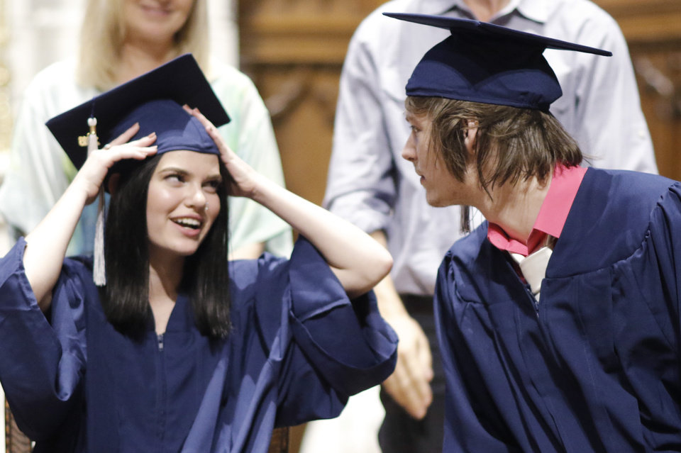 Photo - Savanna adjusts her cap with Joshua looking on, before her introduction, during the Teen Recovery Solutions (TRS) at Mission Academy high school graduation ceremony at St. Paul's Episcopal Cathedral, 127 NW 7th, in Oklahoma City, Thursday, May 26, 2016. Photo by Doug Hoke, The Oklahoman