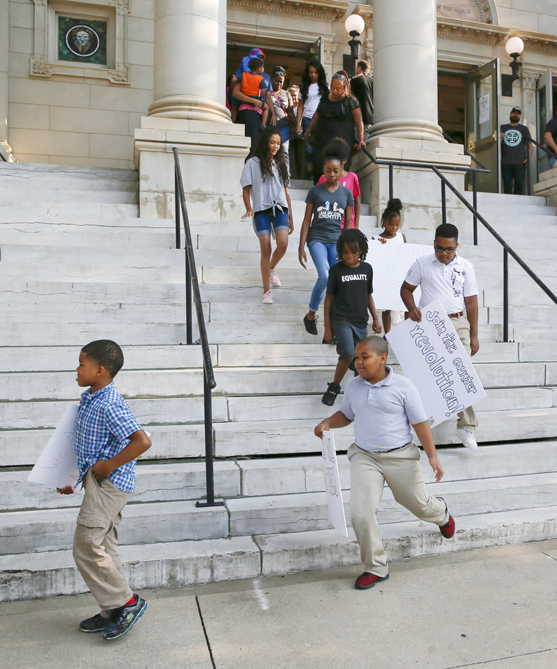 Photo - Children lead a march from Frontline Church, 1104 N Robinson, to Kaiser's Grateful Bean Cafe to commemorate the 60th anniversary of the Katz Drug Store sit-ins, some of the first civil rights protests in the nation, in downtown Oklahoma City, Saturday, Aug. 18, 2018. The first Katz Drug Store sit-in happened on August 19, 1958. Photo by Nate Billings, The Oklahoman