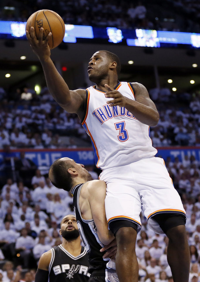 Photo - Oklahoma City's Dion Waiters shoots against San Antonio's Manu Ginobili during Game 4 of the Western Conference semifinals between the Thunder and Spurs in the NBA playoffs at Chesapeake Energy Arena. (Photo by Nate Billings, The Oklahoman)