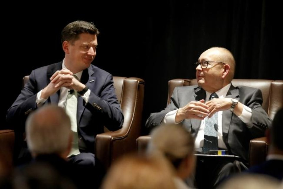 Photo -  Oklahoma City Mayor David Holt, left, and Chickasaw Nation Gov. Bill Anoatubby talk Tuesday during the Downtown Year in Review. [Bryan Terry/The Oklahoman]