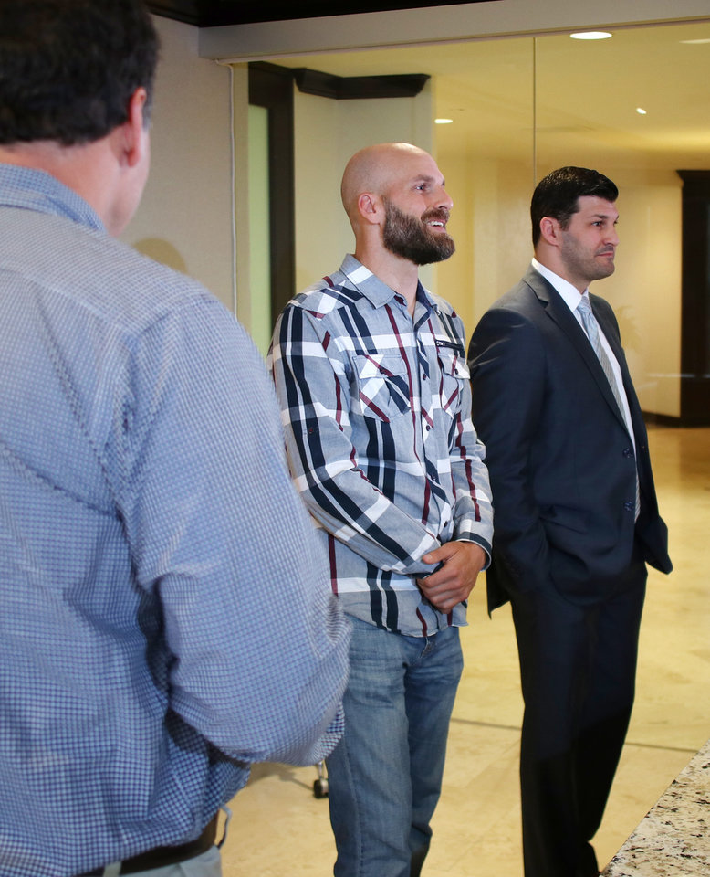 Photo - Scott, Michael and Brett Behenna at a family press conference for the Presidential Pardon Michael Behenna received Monday, in downtown Oklahoma City, Wednesday, May 8, 2019.  Photo by Doug Hoke.