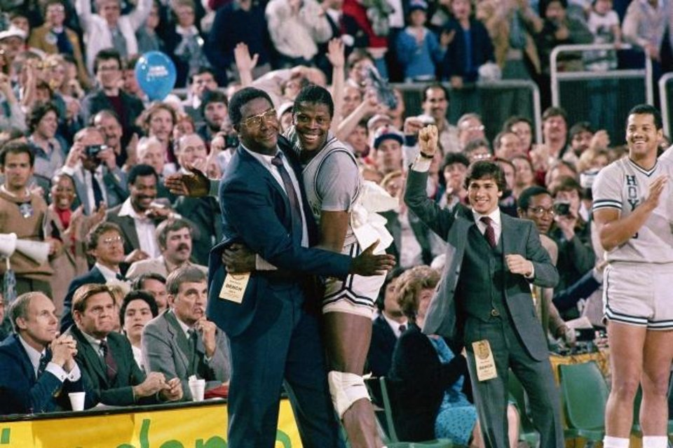 Photo -  Georgetown head coach John Thompson, pictured hugging center Patrick Ewing after defeating Houston for the 1984 NCAA championship, was the first Black head coach to win the Division-I men's basketball title. He turned Georgetown into a powerhouse and opened doors for other Black coaches. He died last August at age 78. [AP Photo/File]