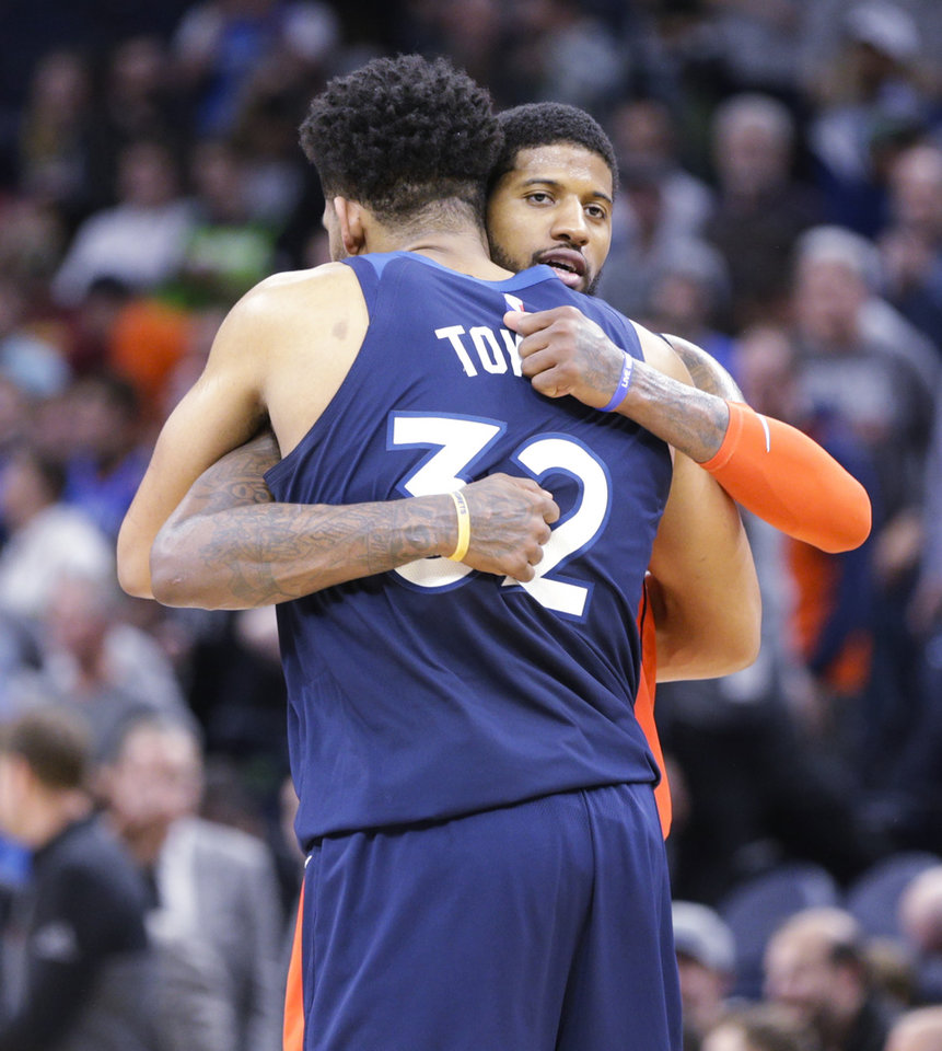 Photo - Oklahoma City Thunder forward Paul George (13) hugs Minnesota Timberwolves center Karl-Anthony Towns (32) after an NBA basketball game Sunday, April 7, 2019, in Minneapolis. Oklahoma won 132-126. (AP Photo/Paul Battaglia)