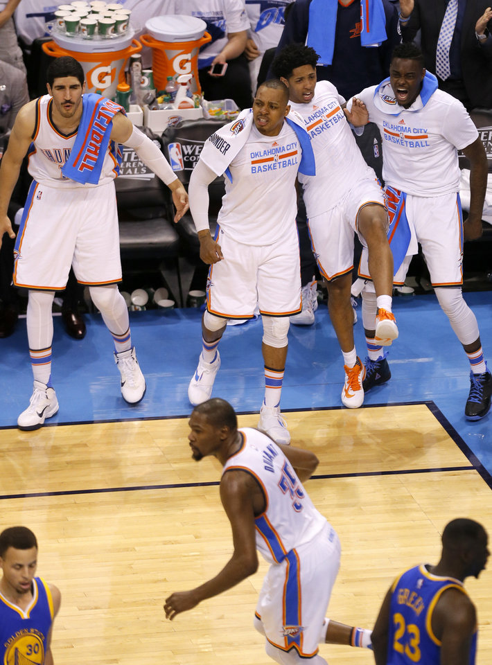 Photo - The Oklahoma City bench celebrates after a Oklahoma City's Kevin Durant (35) dunk during Game 3 of the Western Conference finals in the NBA playoffs between the Oklahoma City Thunder and the Golden State Warriors at Chesapeake Energy Arena in Oklahoma City, Sunday, May 22, 2016. Photo by Sarah Phipps, The Oklahoman