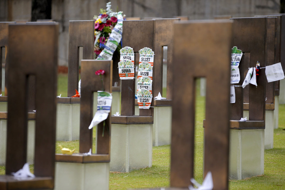 Photo - Ruuner's bibs are placed on chairs at the Oklahoma City National Memorial after the Oklahoma City Memorial Marathon in Oklahoma City, Sunday, April 30, 2017. Photo by Bryan Terry, The Oklahoman