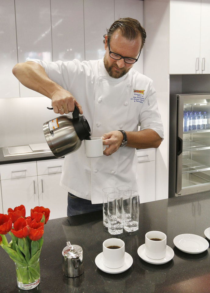 Photo -  Clas Petersson, VP of Product Innovation, pours coffee at Sonic Drive In's new test kitchen at its Bricktown headquarters. Photo by Paul Hellstern, The Oklahoman   PAUL HELLSTERN -  Oklahoman
