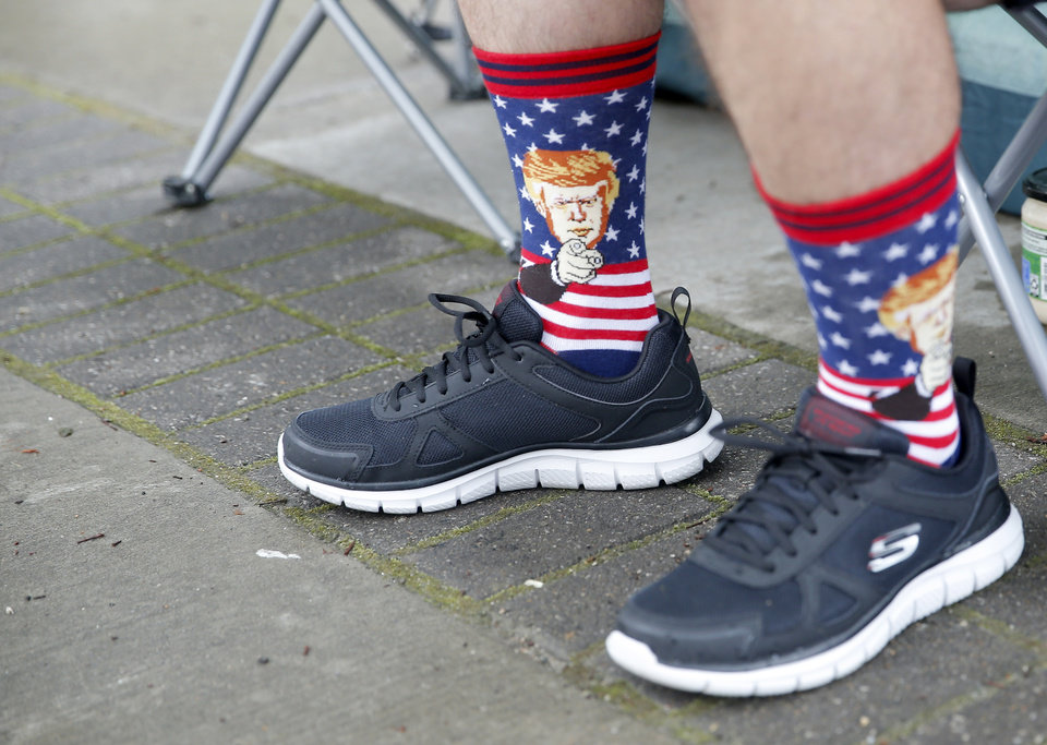 Photo - Ryan Witt wears a pair of Trump socks at his campsite in downtown Tulsa, Okla., ahead of President Donald Trump's Saturday campaign rally, Friday, June 19, 2020. [Sarah Phipps/The Oklahoman] . [Sarah Phipps/The Oklahoman]