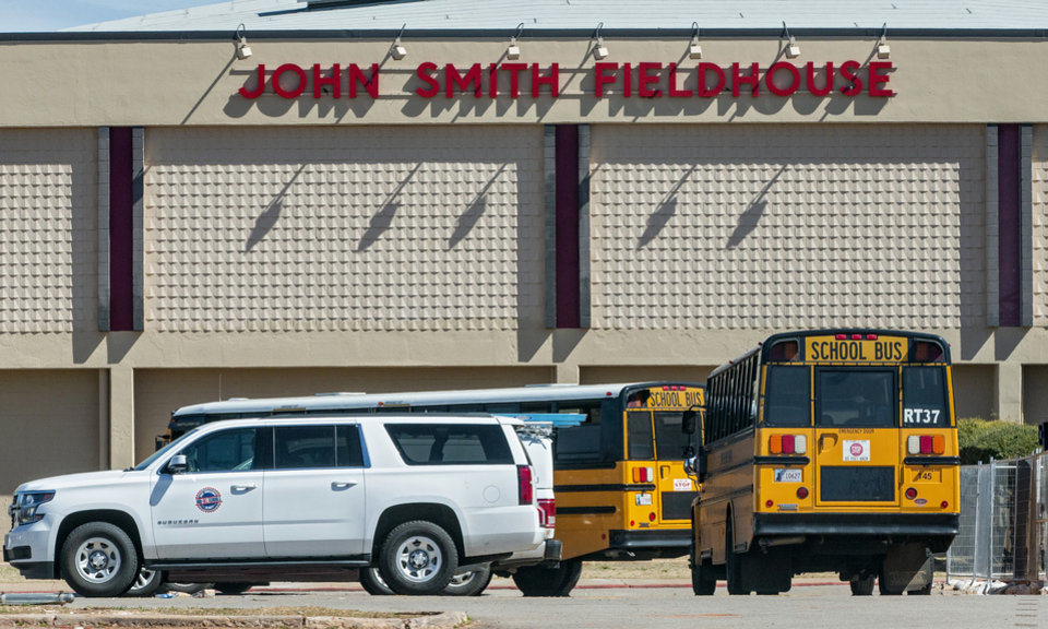 Photo - A school bus arrive at Del City High School in Del City, Okla. on Thursday, March 12, 2020.  Utah Jazz player Donovan Mitchell who tested positive for the coronavirus had a workout session at the school on Tuesday evening.  [Chris Landsberger/The Oklahoman]