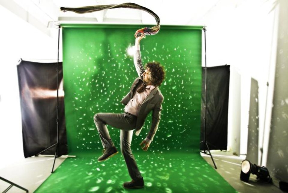 Photo -  Flaming Lips front man Wayne Coyne poses for a photo in the OPUBCO Studio on Tuesday, Dec. 15, 2009, in Oklahoma City, Okla  Photo by Chris Landsberger, The Oklahoman ORG XMIT: KOD