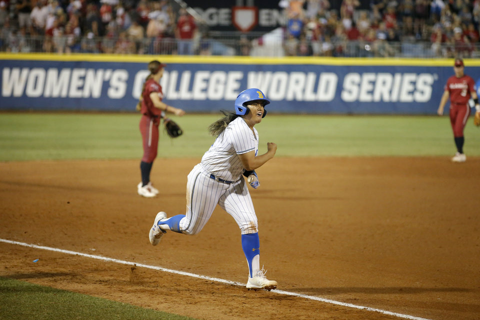 Photo - UCLA's Brianna Tautalafua (33) celebrates after a home run in the fifth inning of the second NCAA softball game in the championship series of the Women's College World Series between Oklahoma and UCLA at USA Softball Hall of Fame Stadium in Oklahoma City, Tuesday, June 4, 2019. UCLA won 5-4. [Bryan Terry/The Oklahoman]