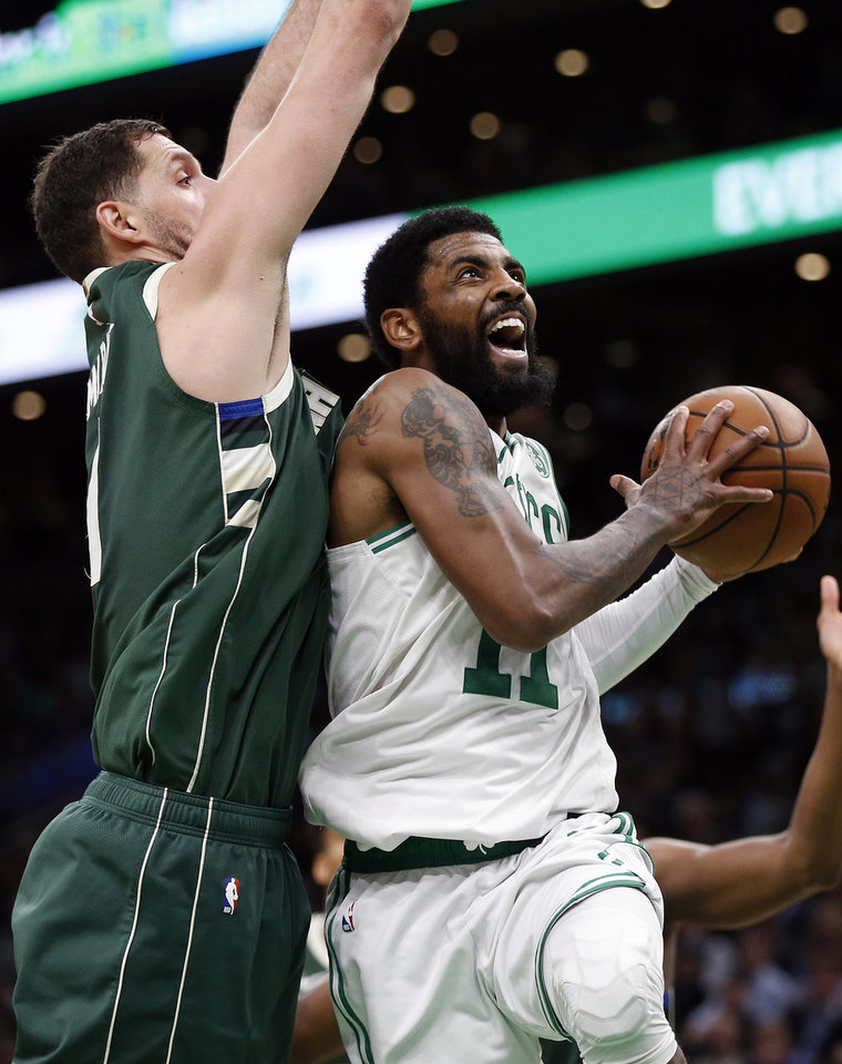 Photo - Boston Celtics' Kyrie Irving (11) shoots against Milwaukee Bucks' Nikola Mirotic during the second half of Game 4 of a second-round NBA basketball playoff series in Boston, Monday, May 6, 2019. (AP Photo/Michael Dwyer)
