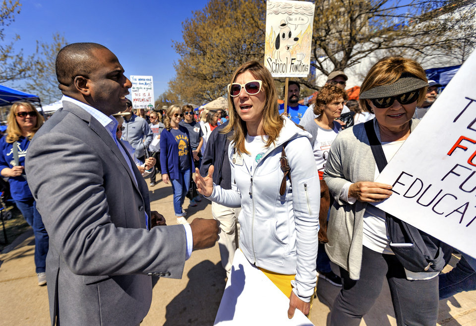 Photo - Edmond Memorial teacher Christine Custred speaks with Rep. Jason Lowe outside the Capitol during the ninth day of a walkout by Oklahoma teachers at the state Capitol in Oklahoma City, Okla. on Tuesday, April 10, 2018.   Photo by Chris Landsberger, The Oklahoman