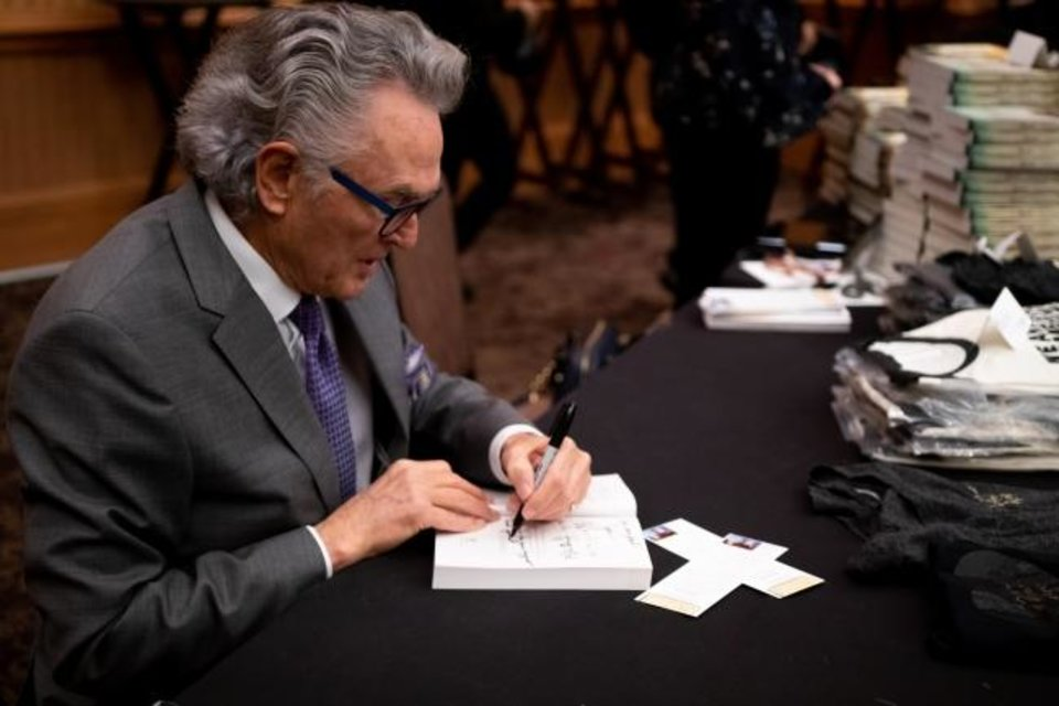 Photo -  Author Ron Hall signs books at last week's Oklahoma Business Ethics Consortium luncheon at the Cox Convention Center. [CHARLIE LUDDEN]