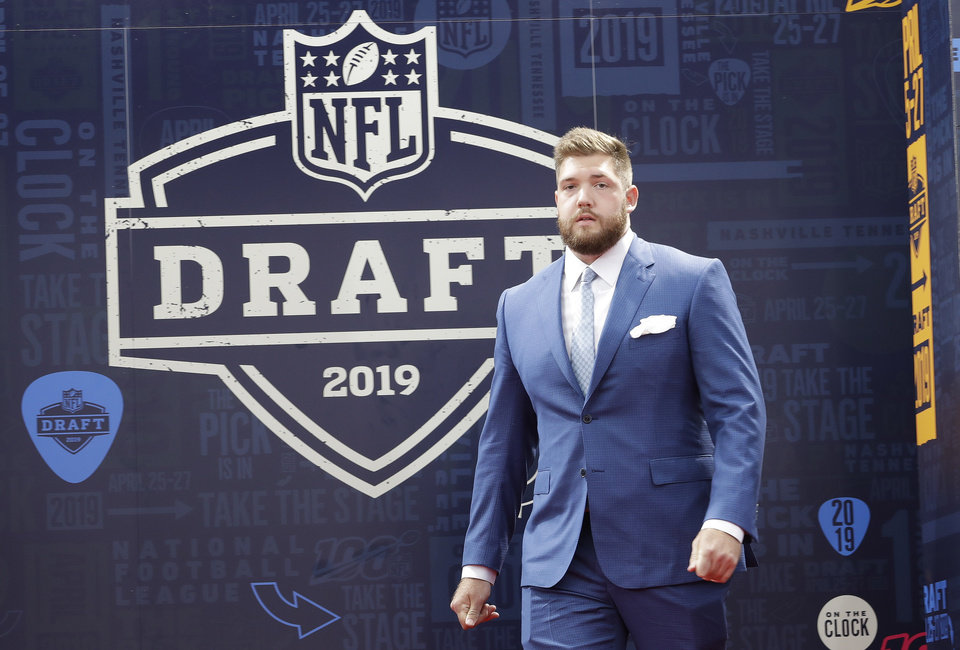 Photo - Alabama tackle Jonah Williams walks the red carpet ahead of the first round at the NFL football draft, Thursday, April 25, 2019, in Nashville, Tenn. (AP Photo/Steve Helber)