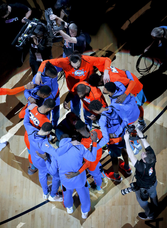 Photo - The Thunder gather before the start of Game 3 in the first round of the NBA playoffs between the Portland Trail Blazers and the Oklahoma City Thunder at Chesapeake Energy Arena in Oklahoma City, Friday, April 19, 2019. Photo by Bryan Terry, The Oklahoman