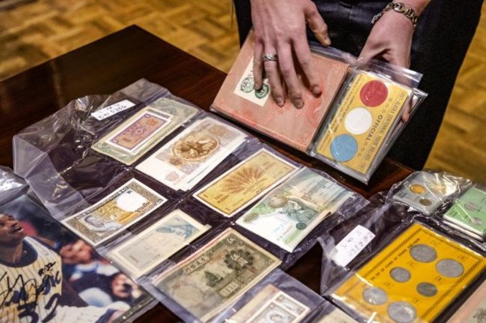 Photo -  Coins and currency are popular finds inside more than 600 abandoned safe deposit boxes. The contents will be auctioned off next week by the Oklahoma State Treasurer's office.