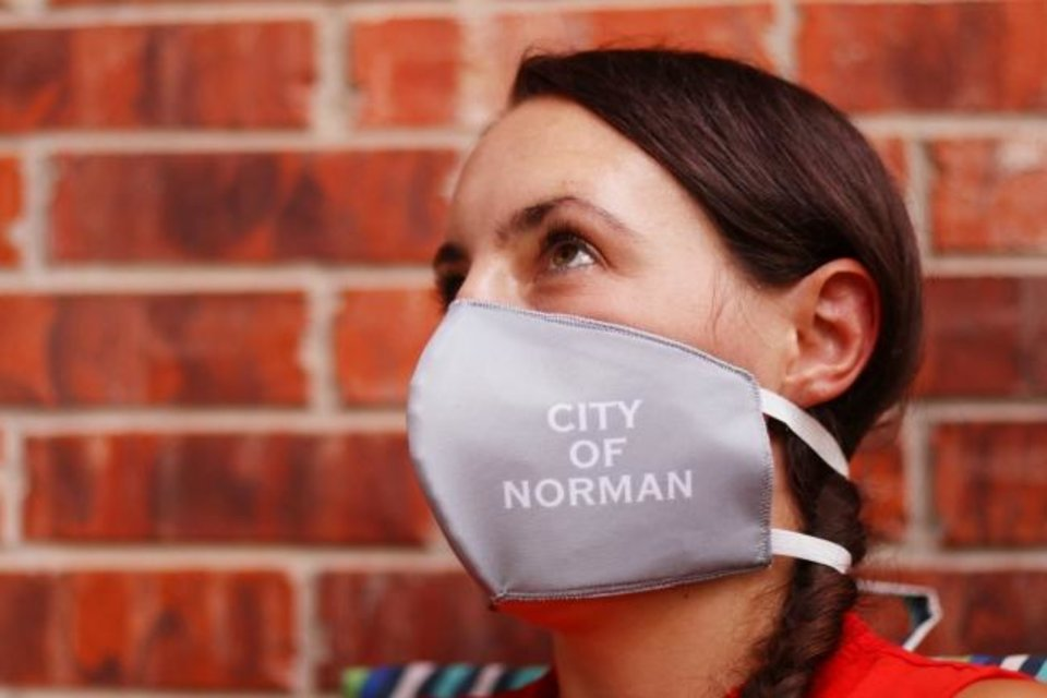 Photo -  Norman Mayor Breea Clark wears a mask that promotes the city of Norman. [Doug Hoke/The Oklahoman]