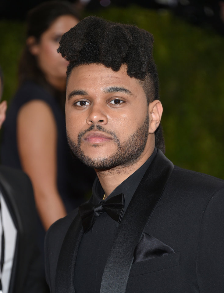 Photo -  The Weeknd  [Photo by Evan Agostini/Invision/AP]