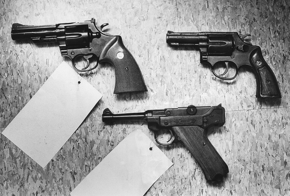 Photo -   Guns used in slayings are .357 Magnum, top left, which killed steakhouse employees; .38 caliber Taurus, right, which killed Texas family; and at bottom a .22 caliber automatic found with death weapons. [Oklahoman Archives photo]
