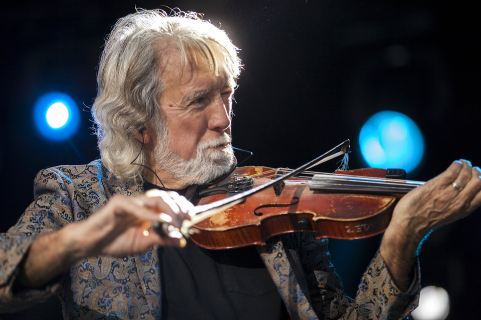 Photo -  John McEuen, of Nitty Gritty Dirt Band, headlines the first evening of G Fest 2017. The country rock act celebrated 50 years as a band with the performance. [Photo by Nathan Poppe, The Oklahoman]