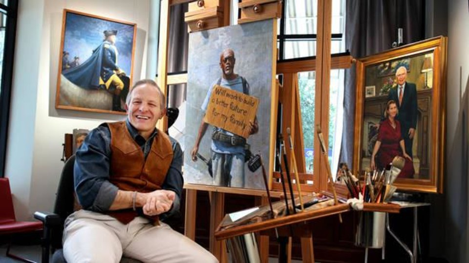 Photo - Mike Wimmer poses with his painting of Wayne Johnson, one of the portraits in his