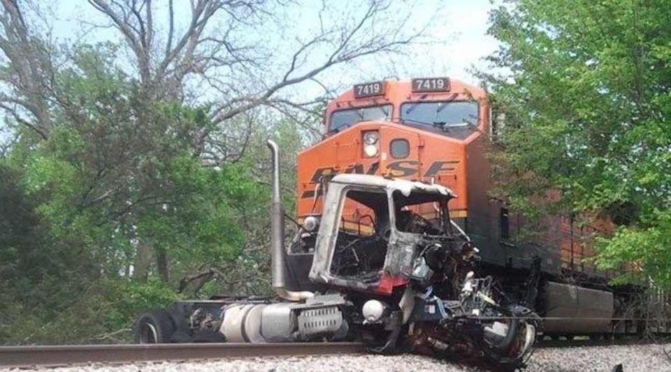 Photo -  This photograph shows the vehicle Richard Knight, 60, of Edmond, was operating, after it had been hit by a BNSF train near a crossing in Lela, west of Pawnee.