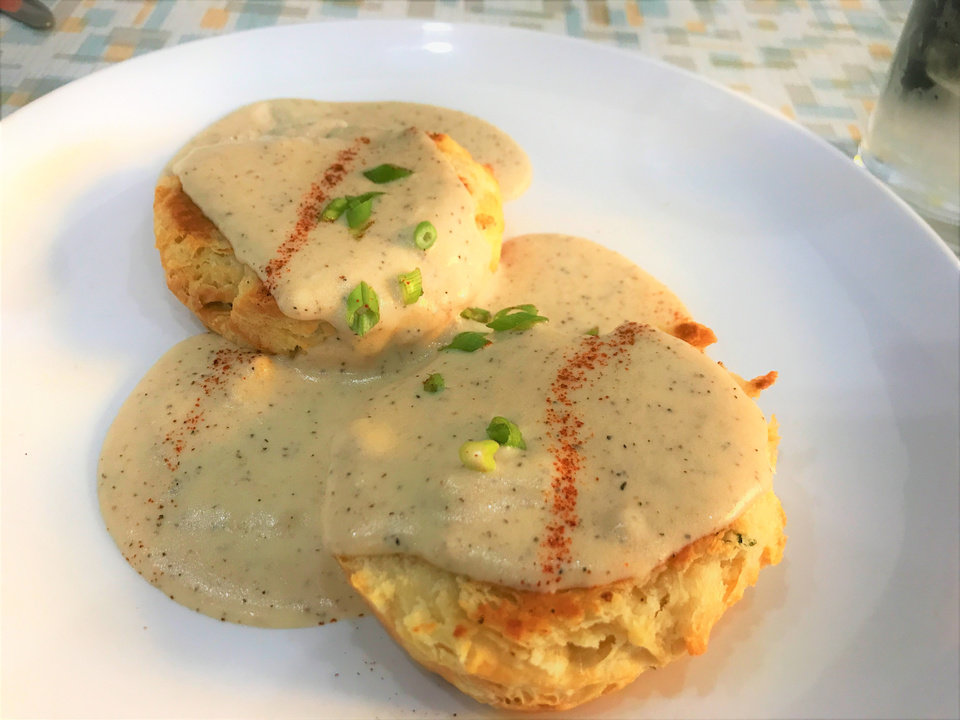 Photo -  Biscuits and gravy from Aurora Breakfast Bar and Backyard in Oklahoma City's Plaza District [Photo by Dave Cathey, The Oklahoman]