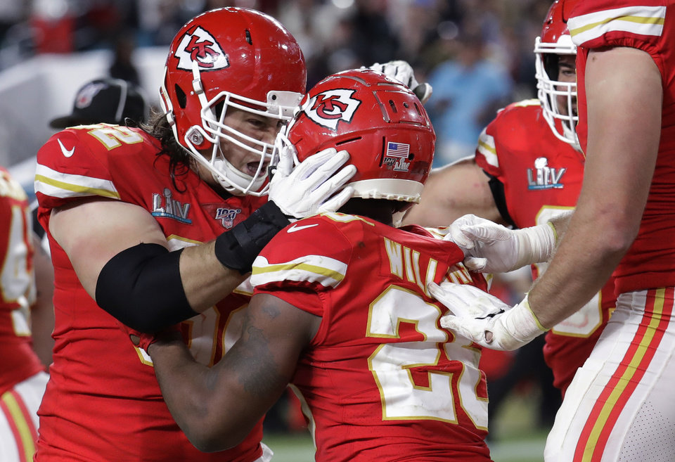 Photo - Kansas City Chiefs' Damien Williams (26) celebrates with teammates after scoring against the San Francisco 49ers during the second half of the NFL Super Bowl 54 football game Sunday, Feb. 2, 2020, in Miami Gardens, Fla. (AP Photo/Lynne Sladky)