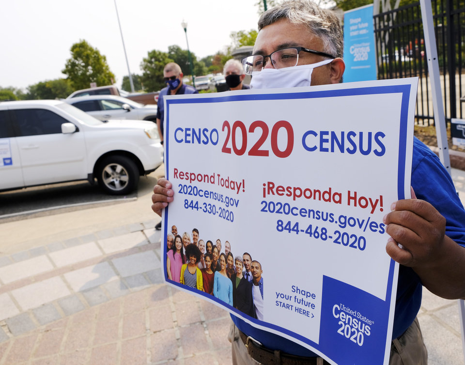 Photo - Jeronimo Gallegos, holds a sign while U.S. Census Bureau Director Steven Dillingham is making a pit stop in Oklahoma to stress the importance of the count.
