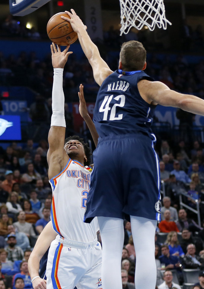 Photo - Dallas' Maxi Kleber (42) blocks a shot by Oklahoma City's Shai Gilgeous-Alexander (2) in the first quarter during an NBA basketball game between the Oklahoma City Thunder and Dallas Mavericks at Chesapeake Energy Arena in Oklahoma City, Monday, Jan. 27, 2020. [Nate Billings/The Oklahoman]