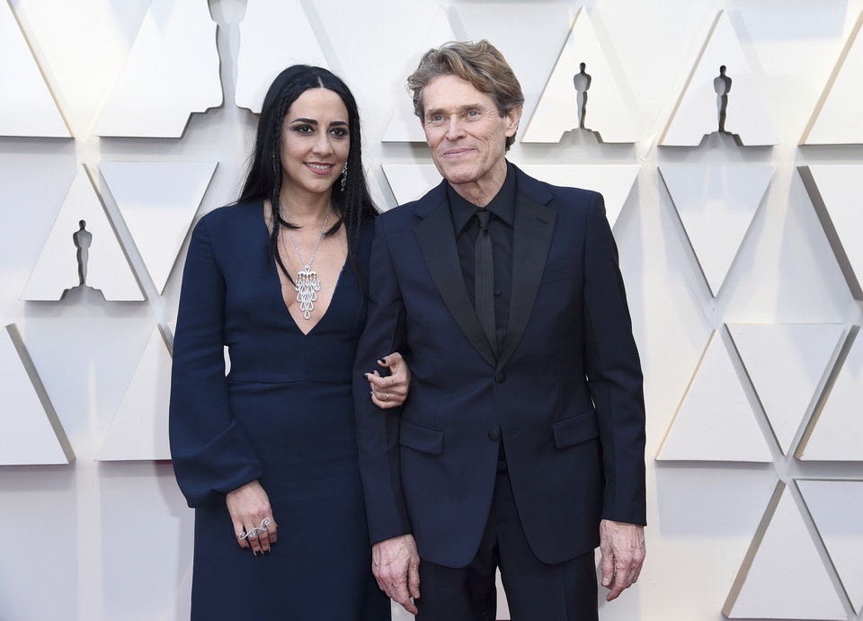 Photo -  Willem Dafoe, right, and Giada Colagrande arrive at the Oscars on Sunday, Feb. 24, 2019, at the Dolby Theatre in Los Angeles. (Photo by Richard Shotwell/Invision/AP)