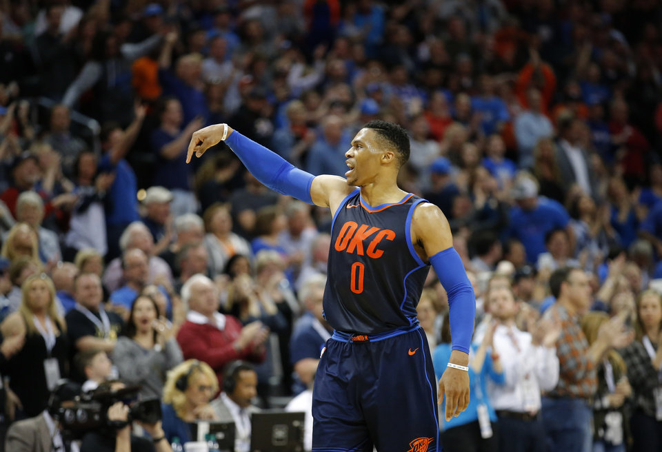 Photo - Oklahoma City's Russell Westbrook (0) reacts during the NBA basketball game between the Philadelphia 76ers and Oklahoma City Thunder at Chesapeake Energy Arena, Sunday, Jan. 28, 2018. Photo by Sarah Phipps, The Oklahoman