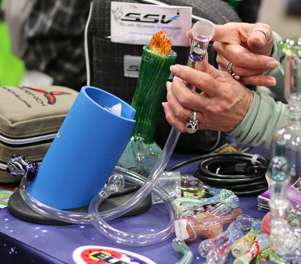 Photo - A variety of smoking accessories available at Mr. Green Dispensary booth at the Green Grow Expo at State Fair Park, Saturday, March 2, 2019.  Photo by Doug Hoke, The Oklahoman