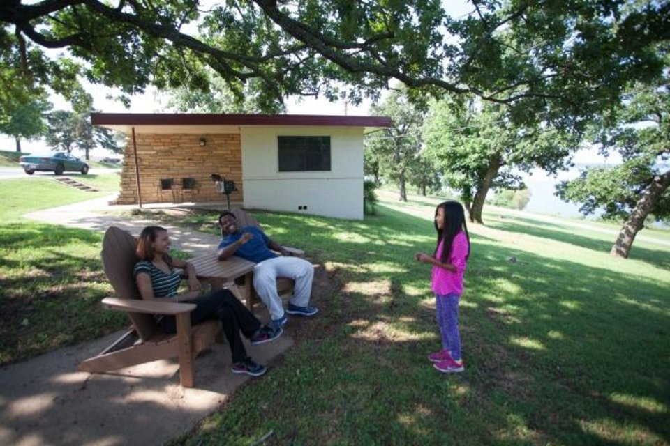 Photo -  Some of the cabins at Sequoyah State Park are lakeside with outdoor decks to enjoy views of Fort Gibson Lake. [Rebekah Morrow/Oklahoma Tourism and Recreation Department]