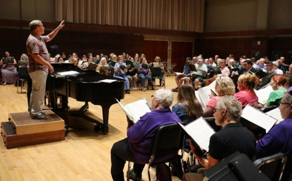 Photo -  Artistic Director Randi Von Ellefson, left, leads Canterbury Voices on Sept. 30 as they rehearse for their Oct. 13 performance of Duke Ellington's