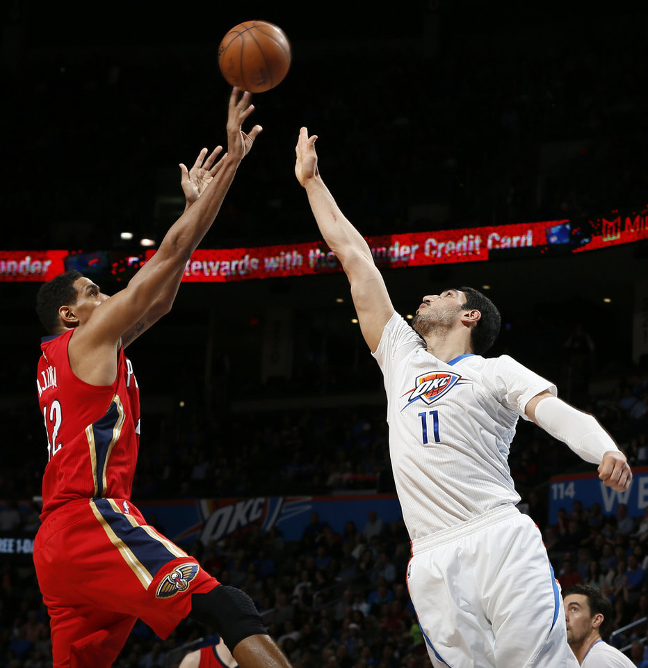 Photo - Oklahoma City's Enes Kanter (11) defends New Orleans' Alexis Ajinca (42) during an NBA basketball game between the New Orleans Pelicans and the Oklahoma City Thunder at Chesapeake Energy Arena in Oklahoma City, Thursday, Feb. 11, 2016. Oklahoma City won 121-95. Photo by Nate Billings, The Oklahoman