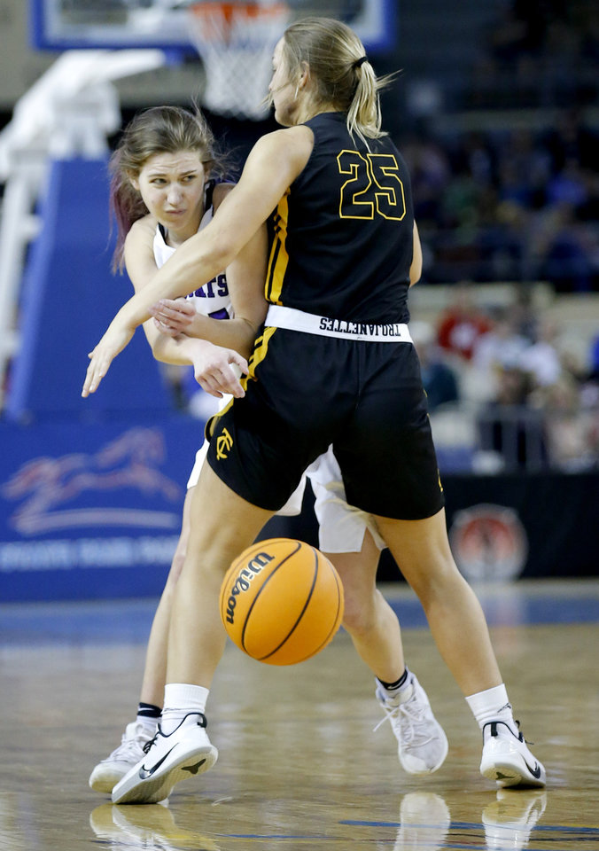 "Photo - Hydro-Eakly's Rachel Barry (24) passes the ball as Canute's Madison Faylor (25) defends during the Class A girls basketball tournament championship game between Hydro-Eakly and Canute inside Jim Norick Arena, ""The Big House,"" at the OKC Fairgrounds in Oklahoma City,  Saturday, March 7, 2020. [Sarah Phipps/The Oklahoman]"