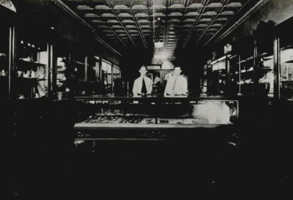 Photo -  Clerks stand in the B.C. Clark Jewelry Store in Purcell around 1900. [Oklahoma Publishing Company Photography Collection, OHS]